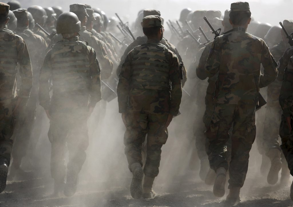 File photo of Afghan National Army (ANA) officers marching during a training exercise at the Kabul Military Training Centr...