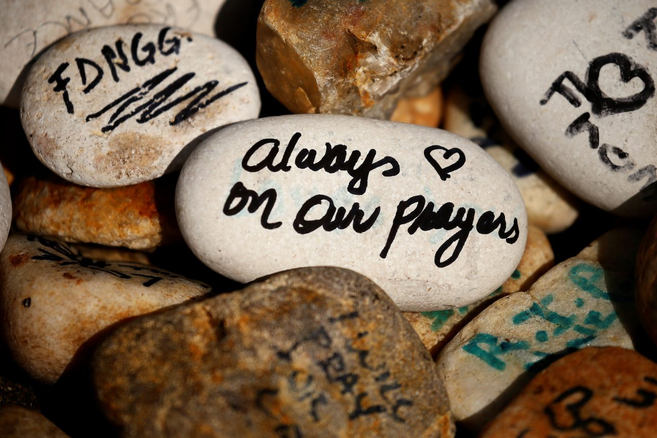 Rocks are printed with words of encouragement outside the Pulse night club following the shootings earlier this year in Orlando