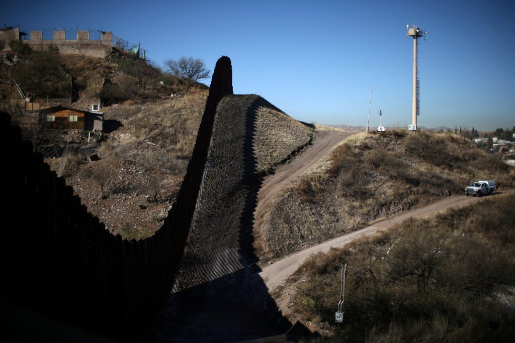 A U.S. border patrol agent patrols the U.S. border with Mexico in Nogales