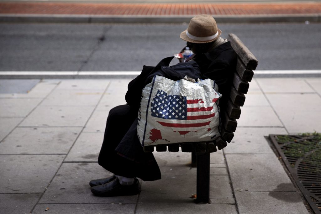 """A homeless woman sits on a bench few blocks away from the White House in downtown Washington, September 1, 2015. A report by the Metropolitan Washington Council of Governments gave a one-day """"snap-shot"""" that counted more than 11,600 homeless people on January 28 in nine metropolitan Washington area jurisdictions. A lack of affordable housing, combined with stagnant or falling wages, has been cited by experts as a key contributing factor to homelessness in a number of U.S. cities. REUTERS/Carlos Barria - RTX1QO3K"""