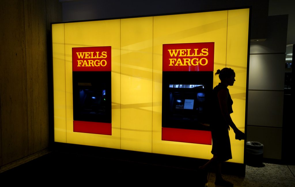 A customer leaves an ATM at the Wells Fargo & Co. bank in downtown Denver. Photo by Rick Wilking/Reuters
