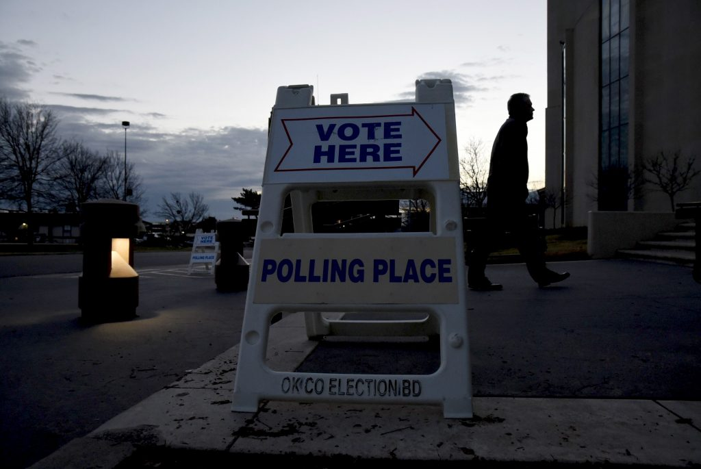 An early morning voter walks into St. Lukes United Methodist Church to cast their vote in Oklahoma City, Oklahoma March 1, 2016.  Photo Nick Oxford/Reuters