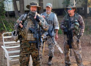 Chris Hill (L), the leader of the Georgia Chapter of the III% Security Force militia, speaks to members during a field training exercise in Jackson, Georgia. Picture taken in October 2016. Photo by Justin Mitchell/Reuters