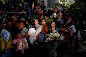 Women carrying babies line up to buy diapers and other supplies outside a pharmacy in Caracas, Venezuela on March 18. Photo by Carlos Garcia Rawlins/Reuters