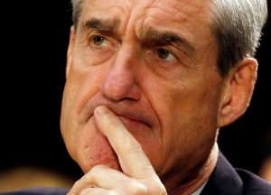 FBI Director Robert Mueller pauses after making an opening statement at the U.S. Senate Judiciary Committee hearing on Capitol Hill in Washington, D.C. in June 2013. Photo by Larry Downing/Reuters
