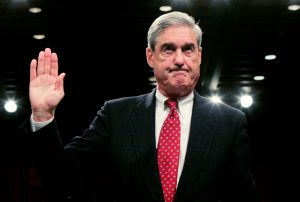 """FILE PHOTO: FBI Director Robert Mueller is sworn in to testify before the Senate Judiciary Committee during a hearing on """"Oversight of the Federal Bureau of Investigation (FBI),"""" on Capitol Hill in Washington September 17, 2008. REUTERS/Molly Riley/File Photo TPX IMAGES OF THE DAY - RTX36AYB"""