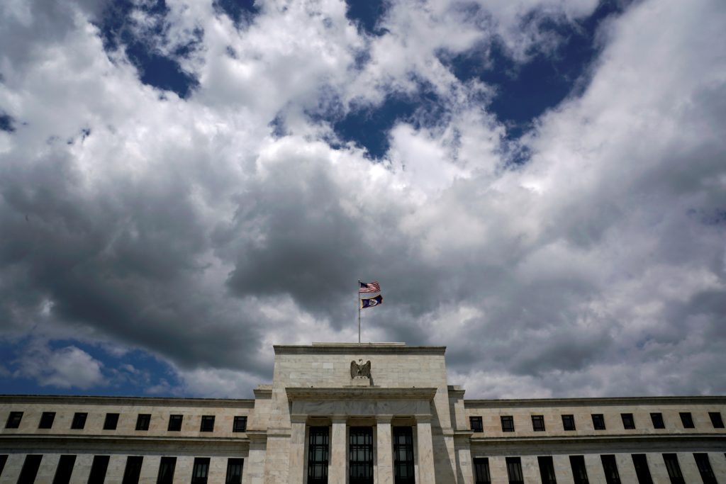 Flags fly over the Federal Reserve Headquarters on a windy day in Washington, U.S., May 26, 2017. REUTERS/Kevin Lamarque - RTX37STN