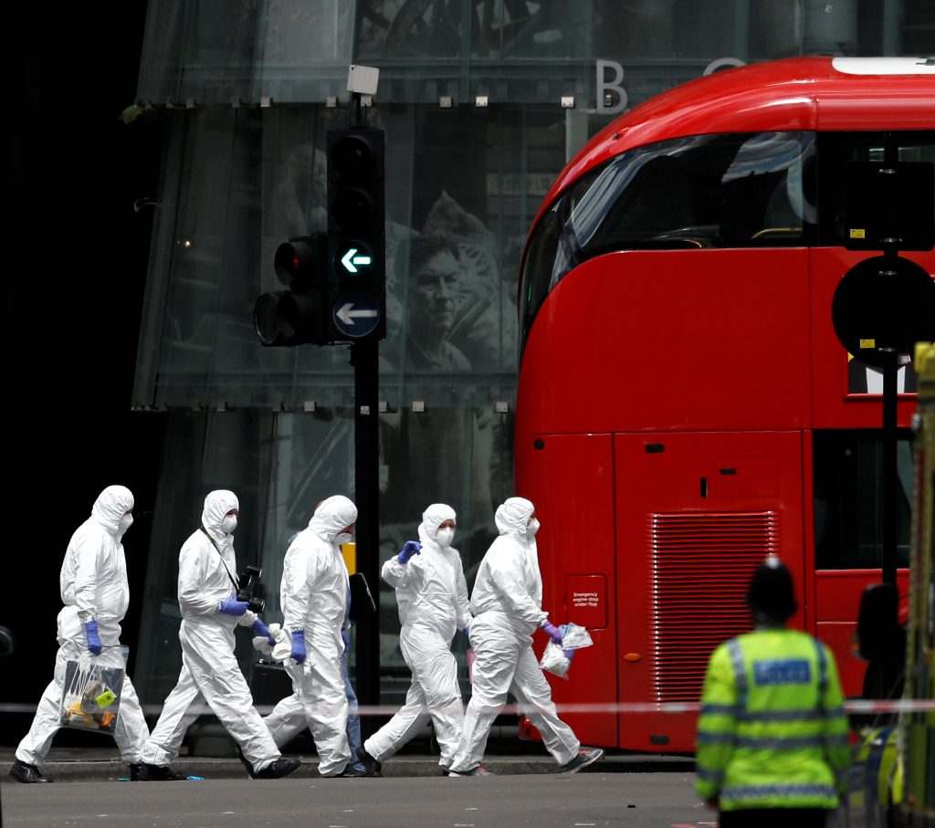 Police forensic investigators work outside Borough Market after an attack left 7 people dead and dozens injured in London