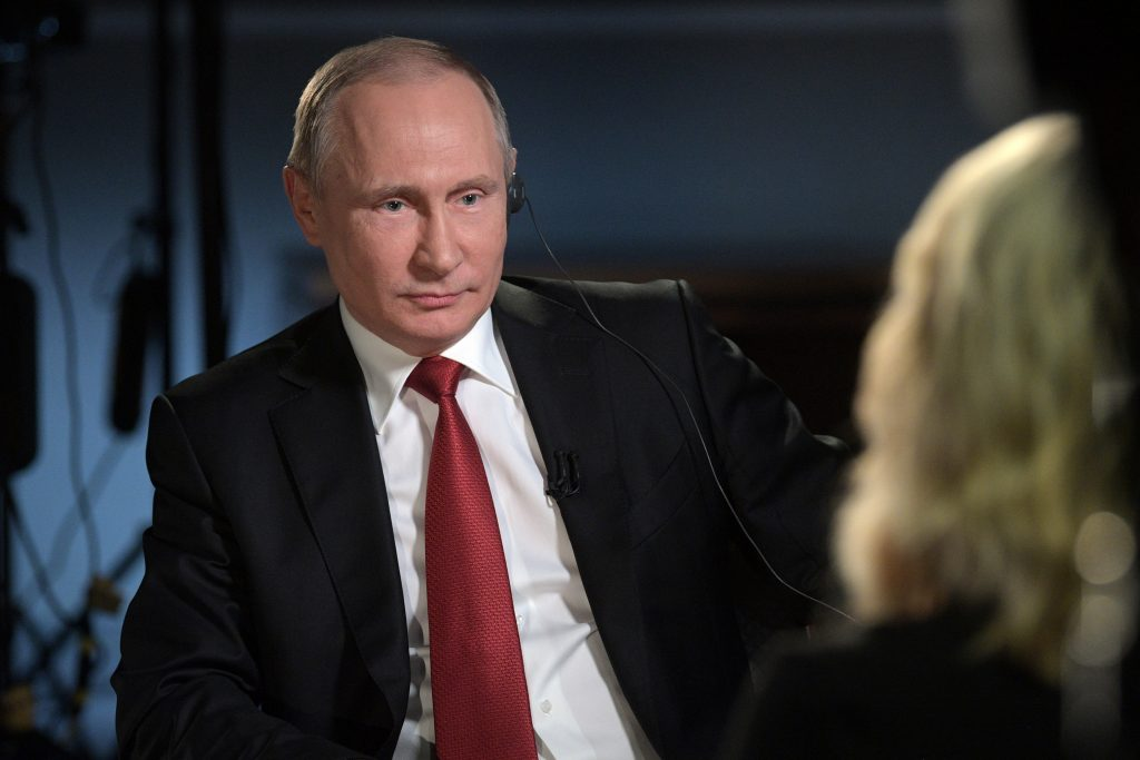 Russian President Vladimir Putin speaks with journalist Megyn Kelly during an interview on the sidelines of the St. Peters...