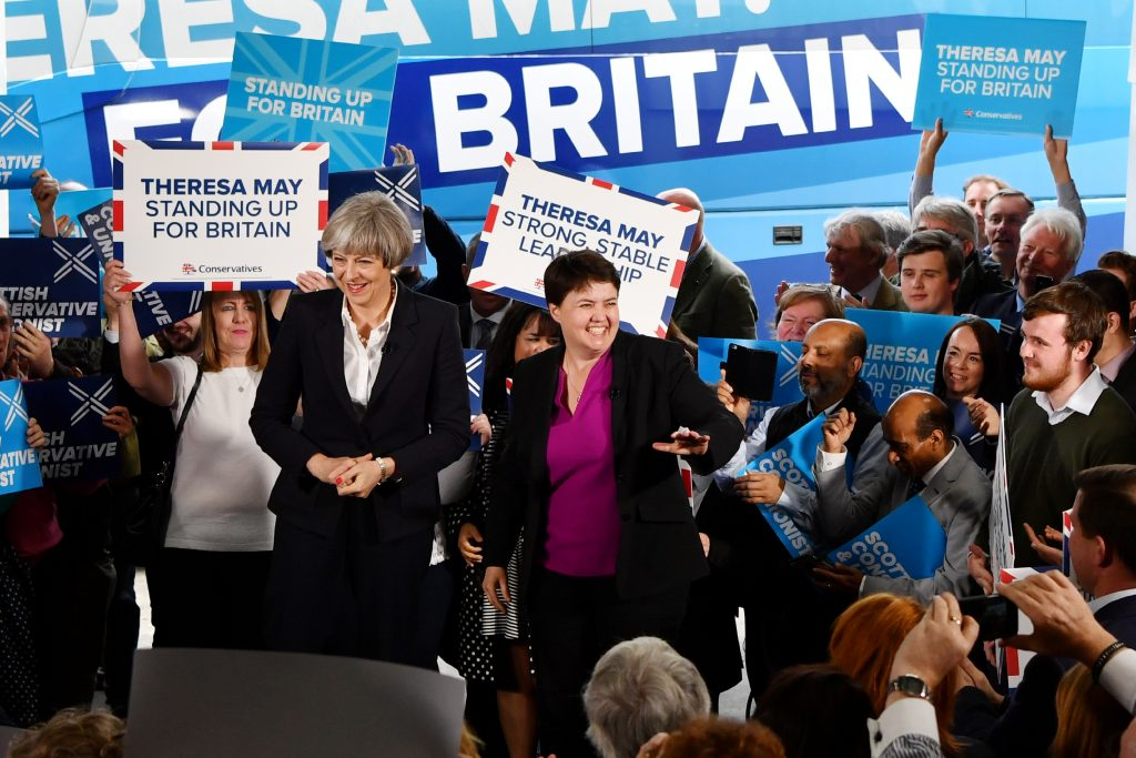 Britain's Prime Minister Theresa May and Scottish Conservative and Unionist Party leader Ruth Davidson speak during a general election campaign event in Edinburgh, Scotland, on June 5. Photo by Ben Stansall/Pool via Reuters