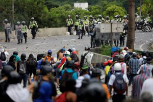 Demonstrators against Venezuela's President Nicolas Maduro clash with riot police in Caracas on June 5. Photo by Carlos Garcia Rawlins/Reuters
