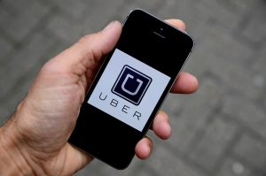 File Photo of Uber app by Toby Melville/Reuters