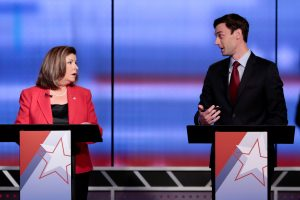 Republican candidate Karen Handel and Democratic candidate Jon Ossoff exchange words moments before Georgia's 6th Congressional District special election debate at WSB-TV studios in Atlanta, Georgia, U.S. June 6, 2017. REUTERS/Chris Aluka Berry - RTX39CQA