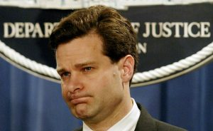 FILE PHOTO: Assistant U.S. Attorney General Christopher Wray pauses during a press conference at the Justice Department in Washington, U.S. November 4, 2003. REUTERS/Molly Riley/File Photo - RTX39FGV