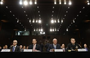 Director of National Intelligence Daniel Coats (2NDR) ; Acting FBI Director Andrew McCabe (L) ; National Security Agency Director Michael Rogers (R); and Deputy Attorney General Rod Rosenstein (2NDL) are seated to testify before a Senate Intelligence Committee hearing on the Foreign Intelligence Surveillance Act (FISA) in Washington, U.S., June 7, 2017. REUTERS/Kevin Lamarque - RTX39GQ2