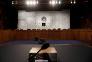 The witness table where former FBI Director James Comey will face the U.S. Senate Intelligence Committee and testify on June 8 about his meetings with President Trump sits at the ready in Washington, D.C. Photo by Jim Bourg/Reuters