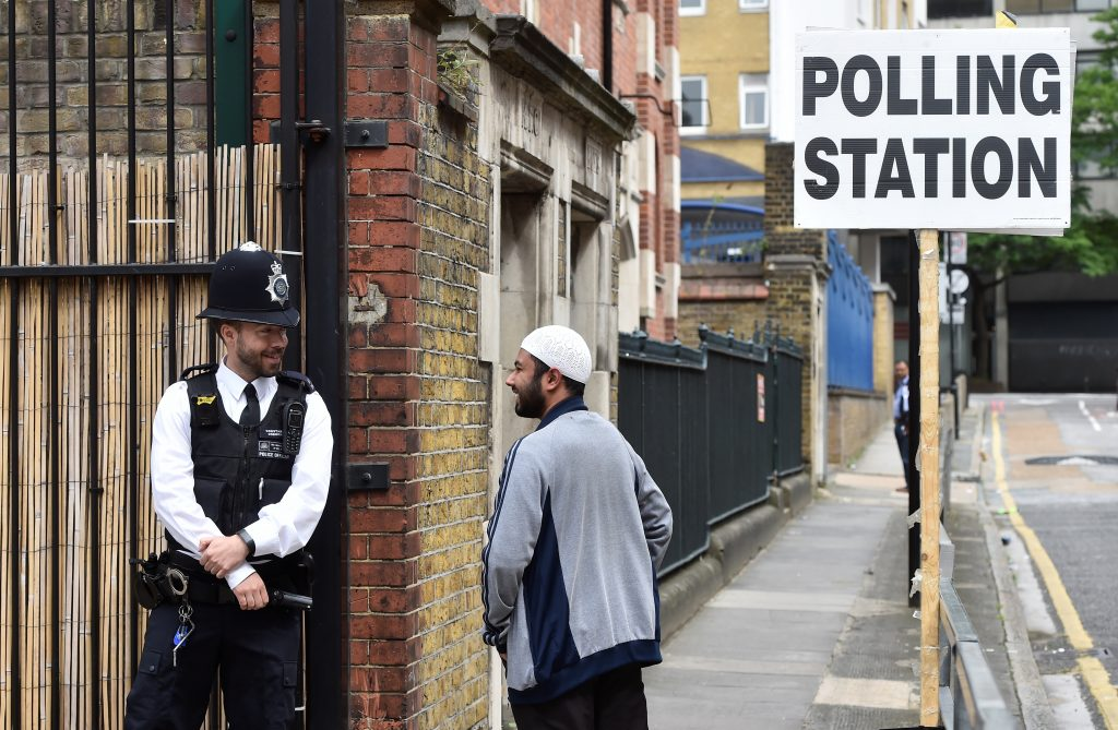 The recent terror attacks caused some polling sits to position armed guards outside. Photo by Hannah McKay/Reuters
