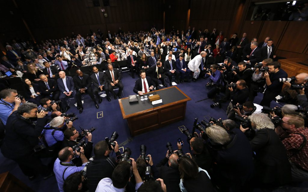 """Former FBI Director James Comey prepares to testify before a Senate Intelligence Committee hearing on """"Russian Federation Efforts to Interfere in the 2016 U.S. Elections"""" on Capitol Hill in Washington, D.C. Photo by Jim Bourg/Reuters"""