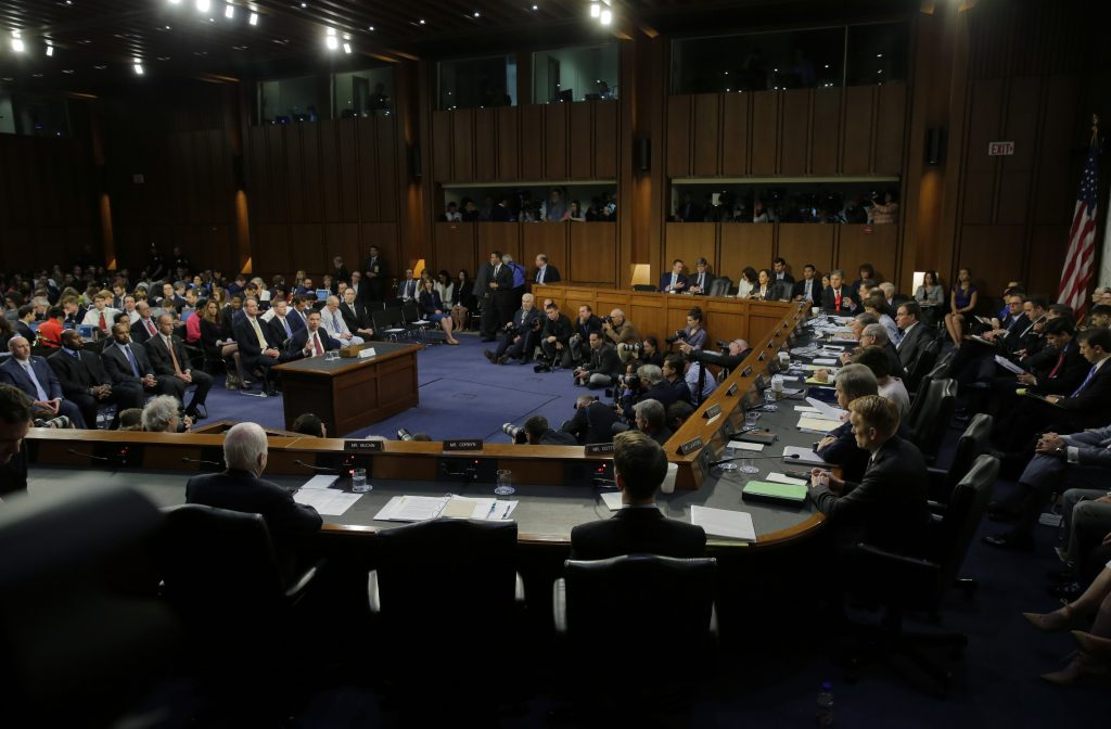 """Former FBI Director James Comey testifies before a Senate Intelligence Committee hearing on """"Russian Federation Efforts to Interfere in the 2016 U.S. Elections"""" on Capitol Hill in Washington, D.C> Photo by Jim Bourg/Reuters"""