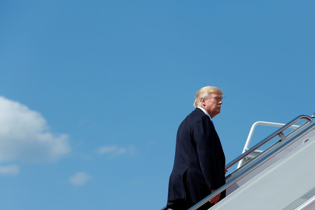 President Donald Trump boards Air Force One at Joint Base Andrews outside D.C. before traveling to New Jersey for the weekend. Photo by Yuri Gripas/Reuters