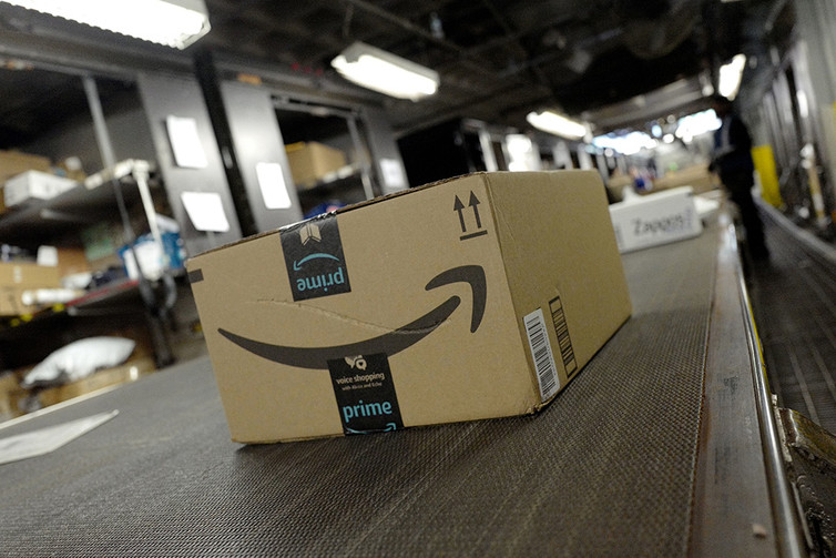 Amazon's success has come partly from shipping as efficiently as possible. AP Photo/Mark Lennihan