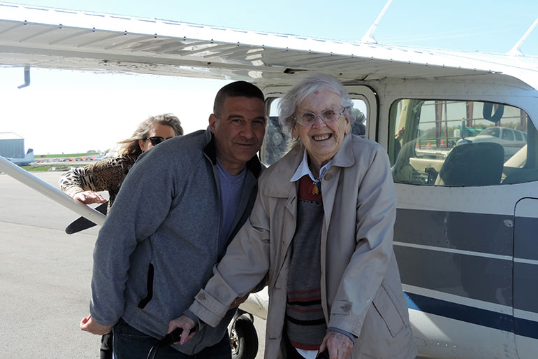 "Mount View owner David Tosetto, left, stands with Mildred ""Milly"" Reeves, right, after her flight in a Cessna Model 172 at the Genesee County Airport. (Courtesy of Mount View Assisted Living)"