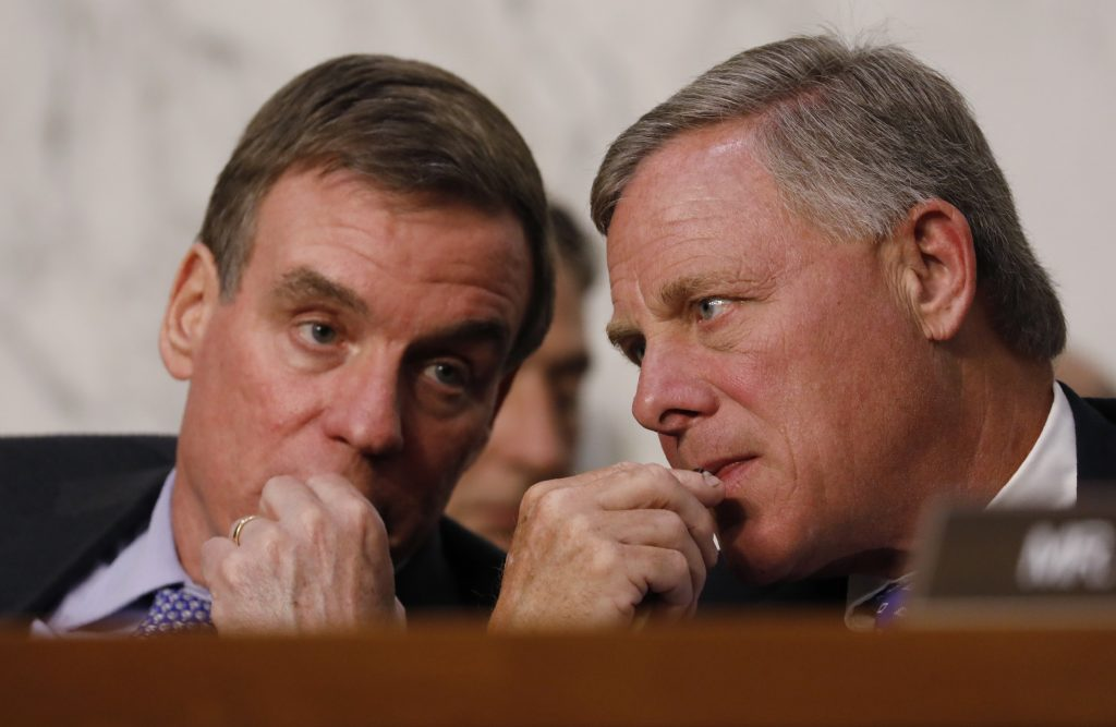 Committee Vice Chairman and ranking member Senator Mark Warner (L) and Chairman Richard Burr (R) listen as U.S. Attorney General Jeff Sessions testifies before a Senate Intelligence Committee hearing on Capitol Hill in Washington, U.S., June 13, 2017. REUTERS/Aaron P. Bernstein - RTS16Y4L