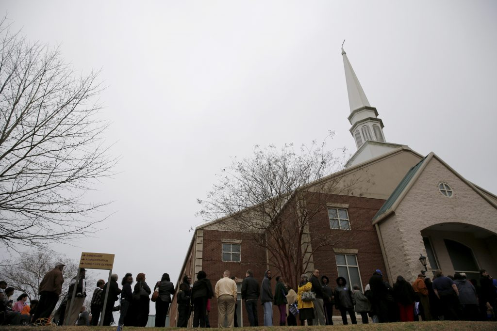 People wait in line to take part in a town hall meeting with U.S. Democratic presidential candidate Hillary Clinton at Central Baptist Church in Columbia, South Carolina February 23, 2016. REUTERS/Jonathan Ernst - RTX28A33