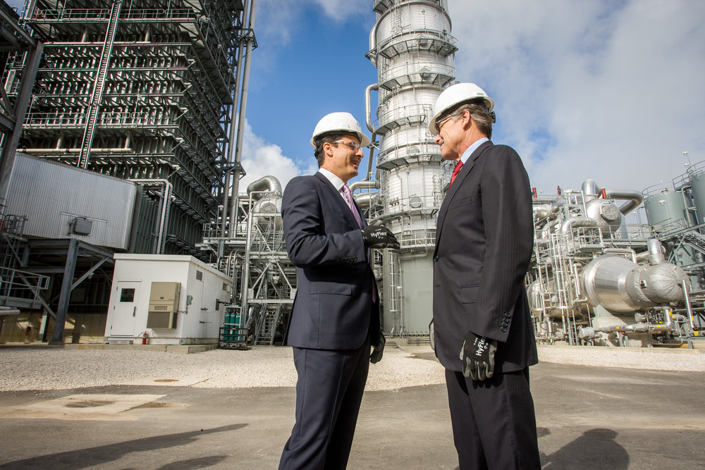 Energy Department head Rick Perry (right) visits NRG's new Petra Nova facility, which captures almost all carbon dioxide from one of its four smokestacks. Photo by NRG