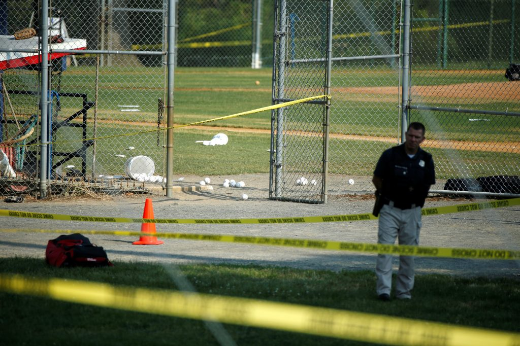 A police officer mans a shooting scene after a gunman opened fire on Republican members of Congress during a baseball practice near Washington in Alexandria, Virginia,  June 14, 2017. Photo by Joshua Robers/REUTERS