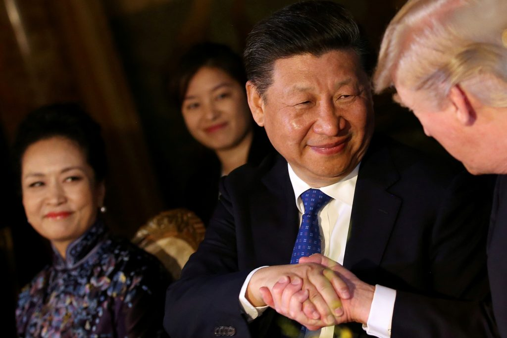 Chinese President Xi Jinping shakes hands with U.S. President Donald Trump as he is accompanied by China's first lady Peng Liyuan during a dinner at the start of a summit between President Trump and President Xi at Trump's Mar-a-Lago estate in West Palm Beach, Florida, U.S., April 6, 2017. Photo by: REUTERS/Carlos Barria/File Photo.