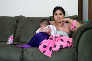 Maria Rios, 20, holds her daughter Aryanna Guadalupe Sanchez-Rios, who was born with microcephaly, on May 3, 2017. Maria, a U.S. citizen, was infected with the mosquito-borne Zika virus while she was living with her husband in Colima, Mexico, last year. (Heidi de Marco/KHN)