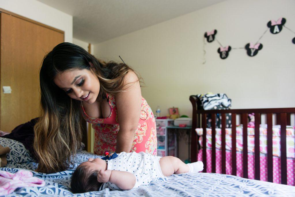 Maria Rios, 20, watches over her baby, Aryanna Guadalupe Sanchez-Rios, on May 4, 2017. (Heidi de Marco/KHN)