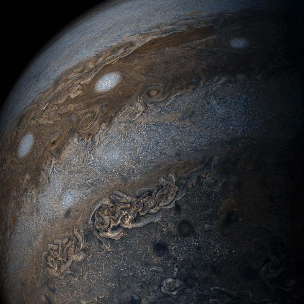 """Three of the white oval storms known as the """"String of Pearls"""" are visible near the top of this image of Jupiter. Juno acquired the image on May 19, 2017. Image by NASA/JPL-Caltech/SwRI/MSSS/Gerald Eichstädt /Seán Doran"""