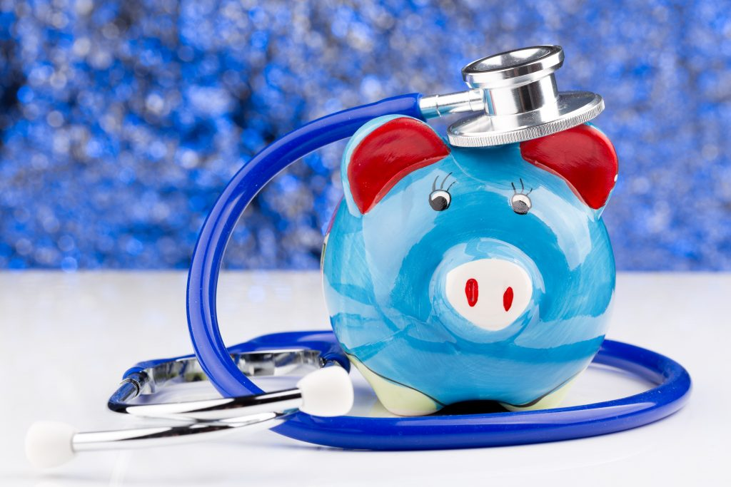 Close up of a stethoscope with a piggy bank. Related words: health care, health care costs, health insurance Photo by m2k7/Adobe Stock