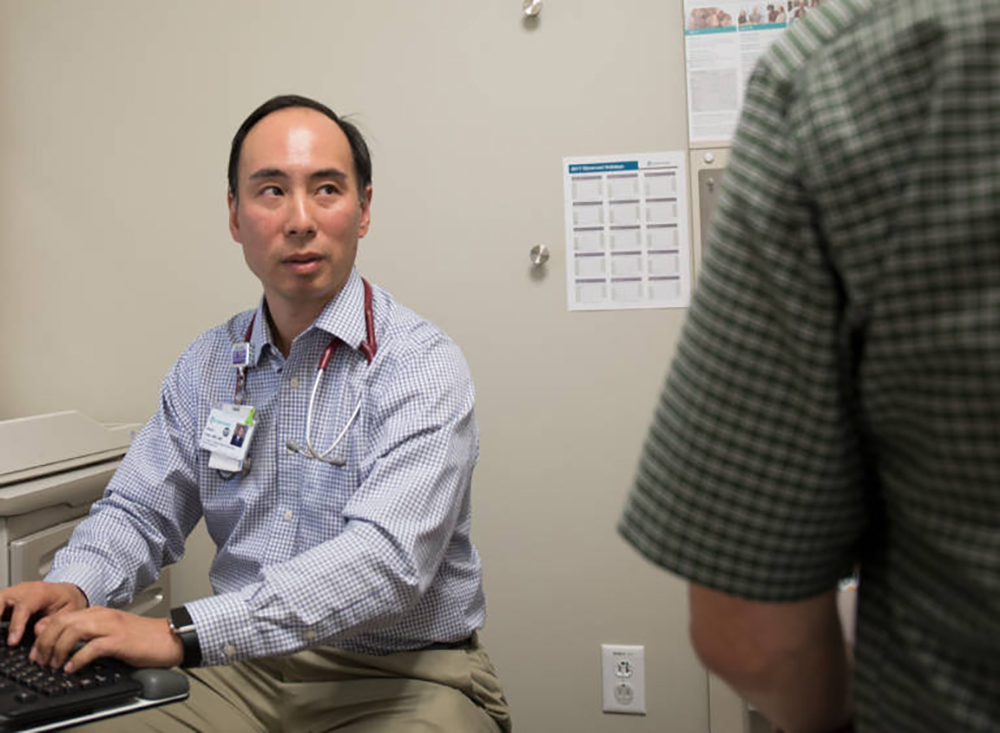 Dr. Albert Chan demonstrates inputting medical information into an electronic health record. Many doctors are fed up with how time-consuming EHRs have become, and how they can impede the doctor-patient relationship during exams. Photo by Serginhoo Roosblad/KQED