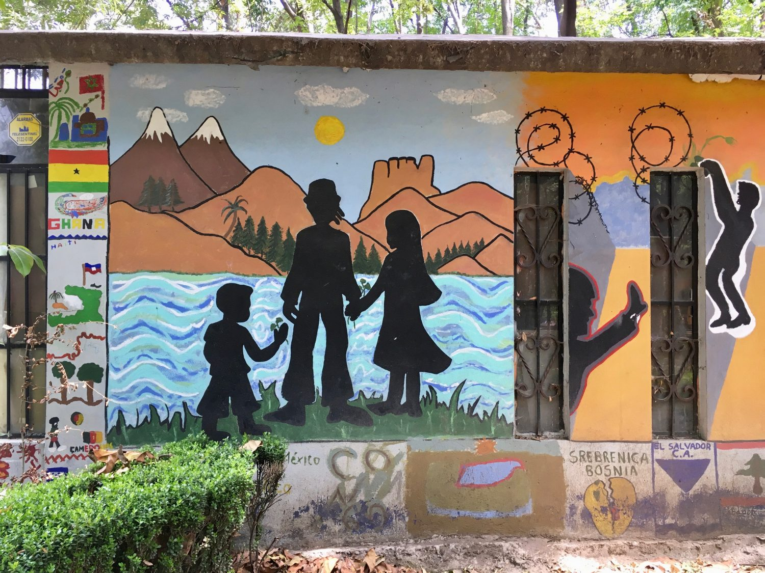 A mural at Mexico City's Casa Refugiados (Refugee House) depicts Central American asylum-seekers gazing across the Suchiate River toward Mexico. Photo by Hannah Carrese