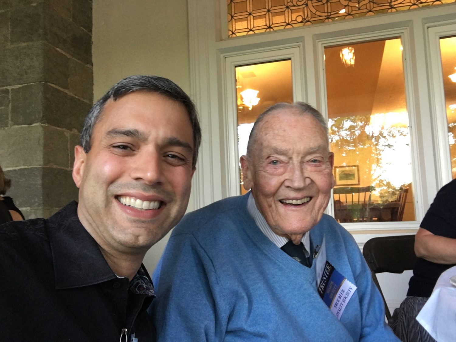 Vikram Mansharamani sits next to Jack Bogle. Photo Courtesy the author.