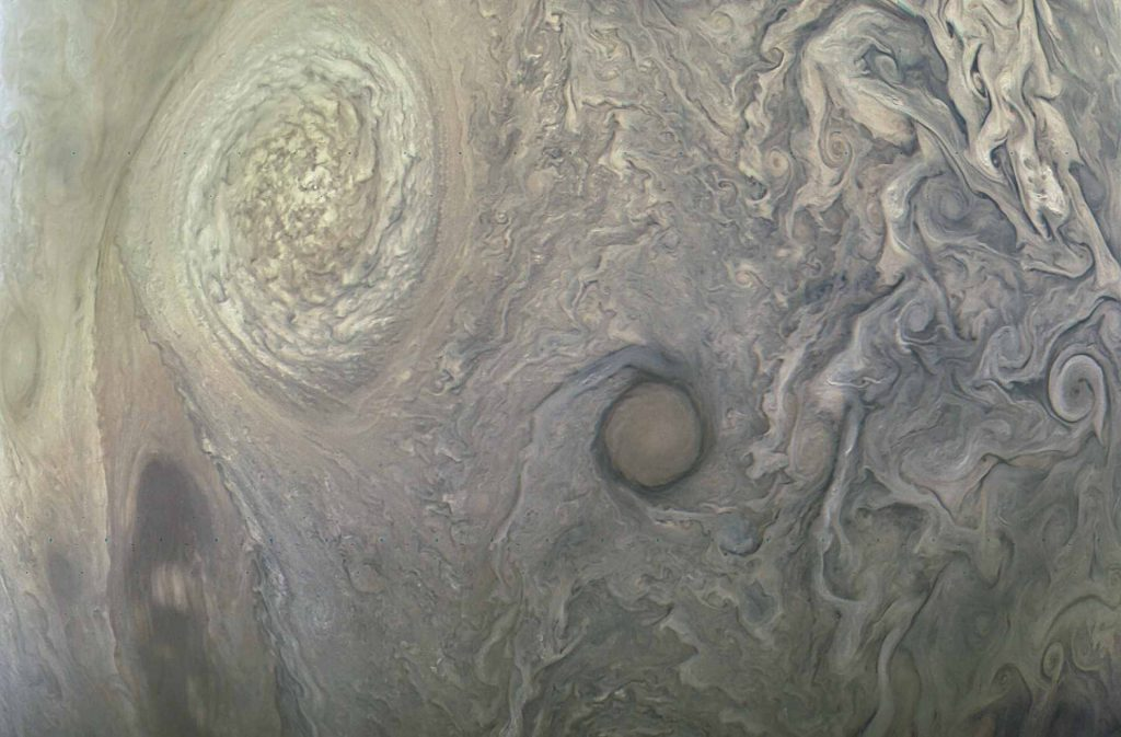 An anti-cyclone called NN-LRS-1 (upper left) swirls in the northern reaches of Jupiter. Photo by NASA/JPL-Caltech/MSSS/SwRI/Kevin M. Gill