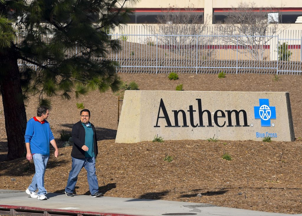 People walk past the office building of health insurer Anthem in Los Angeles, California February 5, 2015. Connecticut and New York prosecutors reached out to No. 2 U.S. health insurer Anthem Inc on Thursday, a day after the firm said it was a victim of a cyberattack that compromised data of tens of millions of people. REUTERS/Gus Ruelas (UNITED STATES - Tags: BUSINESS CRIME LAW HEALTH) - RTR4OEOV