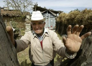 """MEXICAN FORMER GRANDE AS WORKED AS A GUEST WORKER IN THE US SPEAKS DURING A INTERVIEW WITH REUTERS IN TLAXCALA. Mexican farmer Pedro Grande, who worked as a guest worker in the United States picking cotton and vegetables between 1955-66, speaks during a interview with Reuters in his home in Tlaxcala, Mexico, March 4, 2004. Grande, is one of thousands of """"braceros"""", or laborers from """"brazo,"""" the Spanish word for arm, who are demanding compensation from the program which was created to fill a U.S. labor shortage in 1940s to the 1960s. The """"braceros"""" say that 10 percent of their salaries was withheld and deposited in government bank accounts to be distributed later but they never received it. U.S. President George W. Bush in January proposed a program to allow immigrants, most of them Mexicans, to win a three-year temporary work permit. Photo taken March 4, 2004. FOR RELEASE WITH STORY BC-MEXICO-USA REUTERS/Henry Romero - RTRIFW9"""