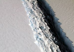 An oblique view of a massive rift in the Antarctic Peninsula's Larsen C ice shelf is shown in this November 10, 2016 photo taken by scientists on NASA's IceBridge mission in Antarctica. Photo by John Sonntag/NASA/Handout via REUTERS