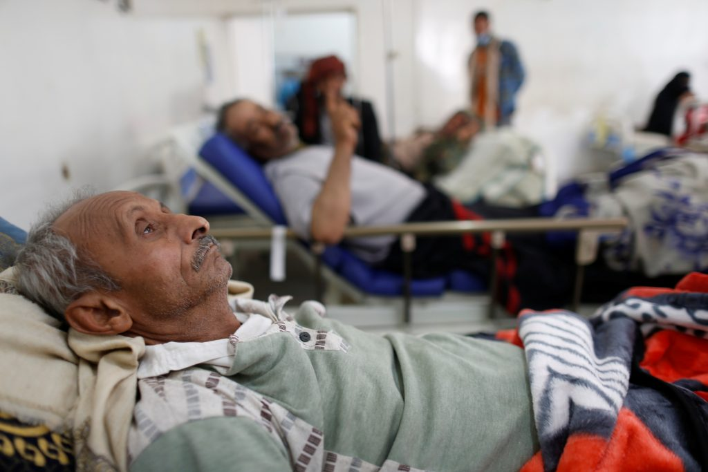 Man lies on the bed of a cholera treatment center in Sanaa, Yemen