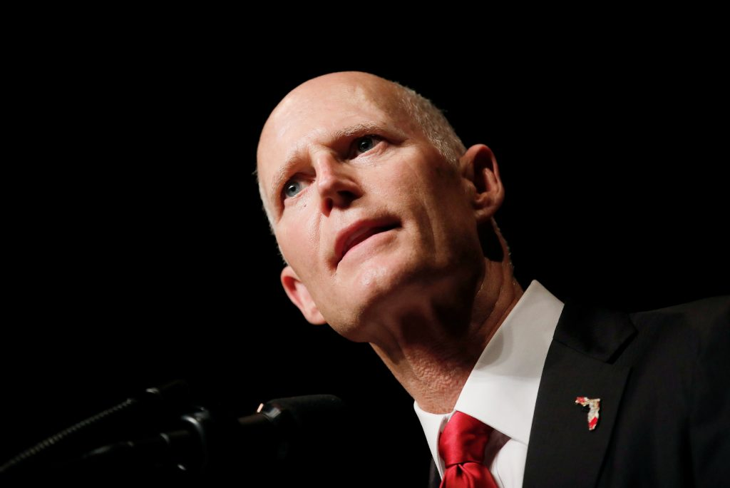 FILE PHOTO -- Florida Governor Rick Scott takes the stage prior to a speech by U.S. President Donald Trump on US-Cuba rela...