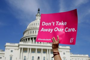 Healthcare activists with Planned Parenthood and the Center for American Progress protest in opposition to the Senate Republican healthcare bill on Capitol Hill in Washington, U.S., June 28, 2017. REUTERS/Joshua Roberts - RTS191DY