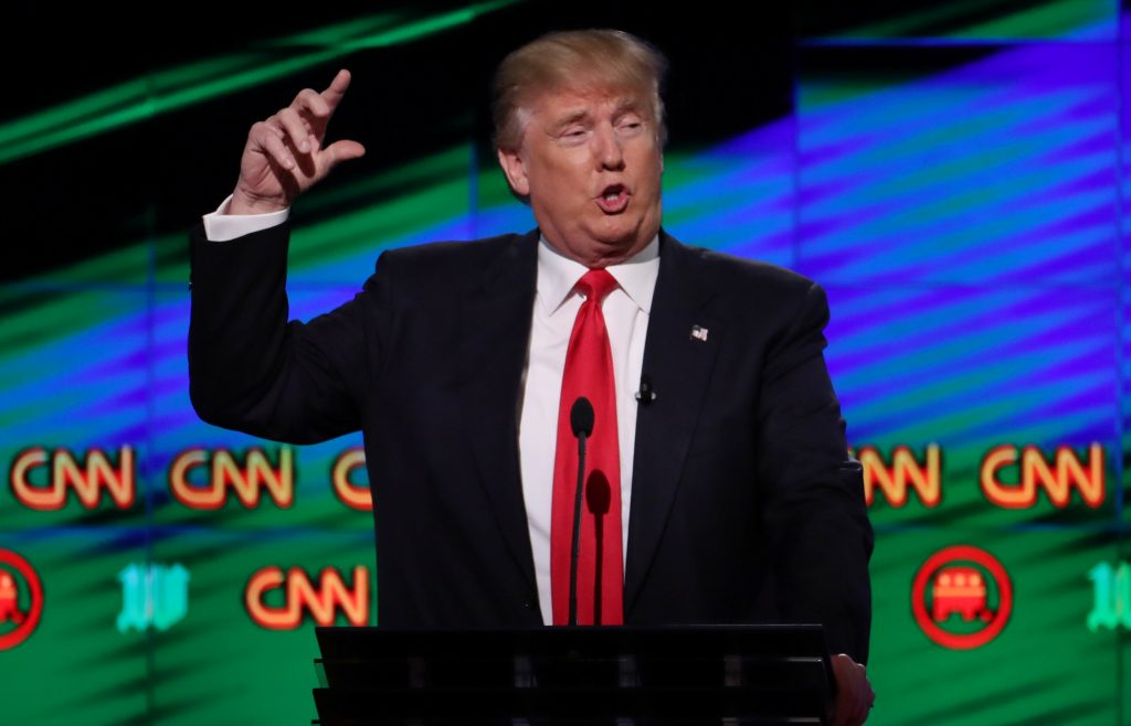 FILE PHOTO: Republican U.S. presidential candidate Donald Trump speaks at the candidates debate in Miami