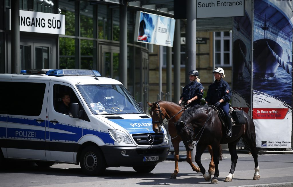 Mounted police patrol outside the Hamburg Messe on July 3 before the upcoming G20 summit in Hamburg, Germany. Photo by Hannibal Hanschke/Reuters