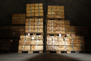 Crated boxes of 57mm caliber rifle cartridges are stacked deep in a munitions bunker at the U.S. Army Letterkenny Munitions Center in Chambersburg, Pennsylvania
