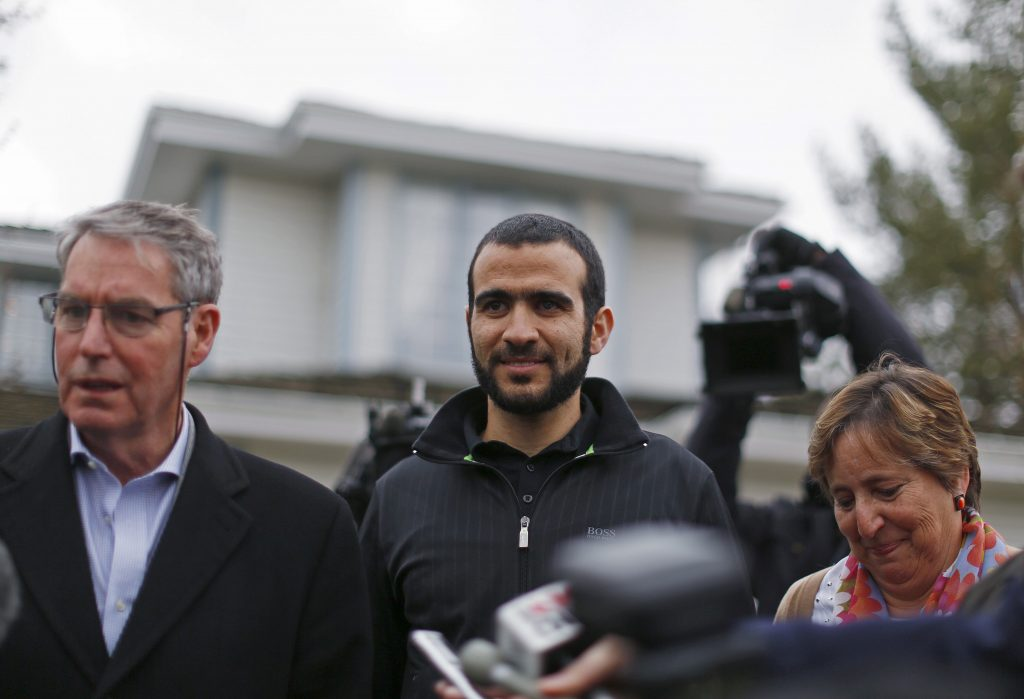 Former Guantanamo prisoner Omar Khadr (center) is pictured here in 2015 with his lawyer Dennis Edney (left) and Patricia Edney. He stayed with the couple after being released on bail in Edmonton, Alberta, Canada. Photo by Todd Korol/Reuters