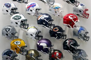 NFL team helmets are displayed at the NFL headquarters in New York in 2015. Photo by Brendan McDermid/Reuters